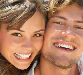 Smiling Couple with Wite Healthy Teeth